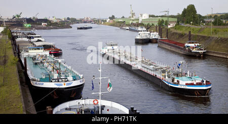 Cargo vessels, inland port in Duisburg, Germany. - Stock Photo