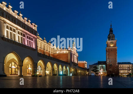 Beautiful view of Cloth Hall (Sukiennice) and Tower Hall (Wieża ratuszowa w Krakowie) in the blue hour, Krakow's Old Town, Poland, main market square - Stock Photo