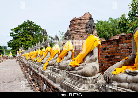 Row of buddha image in wat yai chai mongkol - Stock Photo