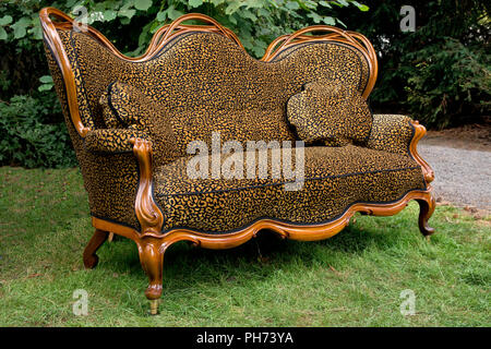 Couch in Garden - Stock Photo