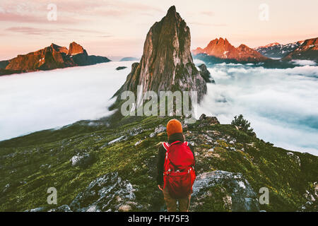 Traveler enjoying sunset Segla mountain  hiking adventure outdoor in Norway active vacations traveling lifestyle - Stock Photo