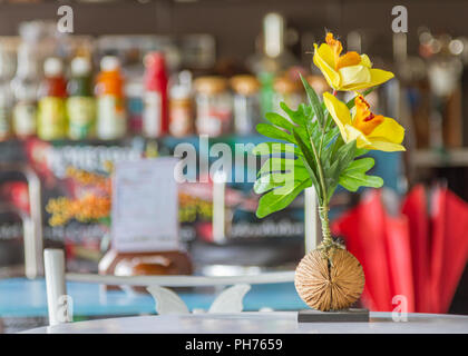Beautiful flowers on wooden table in the shop. - Stock Photo