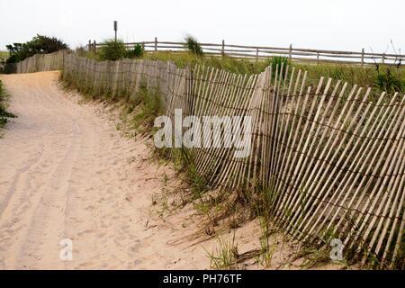 Well traveled sandy path through the sand dune - Stock Photo