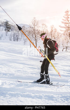 French girl with ski clothing on the ski lift - Stock Photo