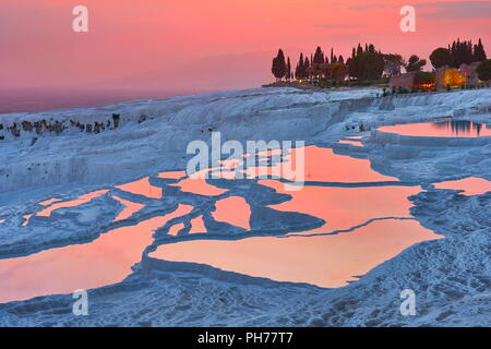Pamukkale limestone terraces at sunset time, Pamukkale, Turkey - Stock Photo