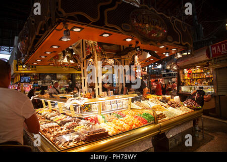 Confectionary Stall in St Josep La Boqueria Market on Las Ramblas in Barcelona, Spain - Stock Photo