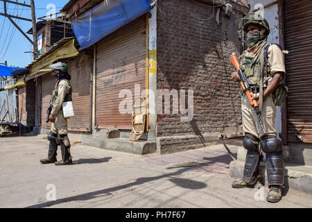 Srinagar, Kashmir. 31st Aug 2018. Government forces stands alert during restrictions in Srinagar.Authorities imposed Restrictions in many parts of Srinagar Summer Capital Of Indian Kashmir on Friday to Prevent the protect called by Joint Resistance Leadership against proposed removal of Article 35-A in State. Kashmir valley observed Complete shutdown in favour to safeguard the Article 35A which grants special rights to the permanent residents. Credit: Idrees Abbas/SOPA Images/ZUMA Wire/Alamy Live News - Stock Photo