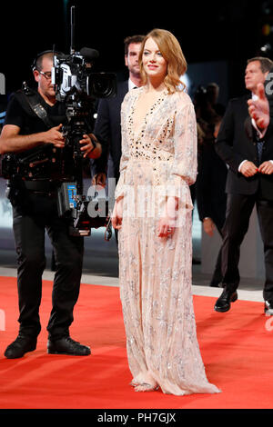 VENICE, ITALY - AUGUST 30: Emma Stone arrives at the 'The Favourite' premiere during the 75th Venice Film Festival at the Palazzo del Cinema on August 30, 2018 in Venice, Italy.  Credit: John Rasimus/MediaPunch  ***FRANCE, SWEDEN, NORWAY, DENARK, FINLAND, USA, CZECH REPUBLIC, SOUTH AMERICA ONLY*** - Stock Photo