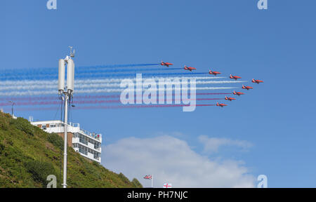 Bournemouth, UK. 31st August, 2018. The RAF Red Arrows put on an impressive aerial display at the Bournemouth Air Festival in Dorset. The free weekend festival goes on until the 2nd September 2018. Credit: Thomas Faull/Alamy Live News - Stock Photo
