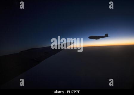 A U.S. Marine Corps EA-6B Prowler, assigned to Marine Tactical Electronic Warfare Squadron 2, flies alongside a KC-135 Stratotanker assigned to the 28th Expeditionary Air Refueling Squadron during an aerial refueling mission in support of Operation Inherent Resolve over Iraq, June 28, 2018. The aircraft has been involved in every American conflict since the Vietnam War.