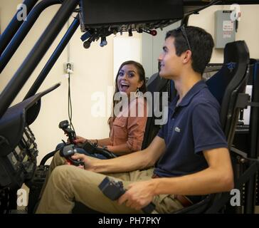 Chasity Allen, 96th Operations Support Squadron, reacts to the helicopter simulator prior to a familiarization flight with the 413th Flight Test Squadron June 27 at Eglin Air Force Base, Fla.  Allen and 11 others are part of the Premier College Intern Program, a three-month paid summer internship with the Air Force.  The program was aimed at juniors in college studying science and engineering. The goal is to recruit the best engineering students for the Air Force. - Stock Photo