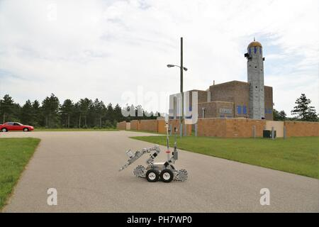 Explosive ordnance disposal personnel operate a remote-controlled robot for a training scenario June 22, 2018, at the Combined Arms Collective Training Facility at Fort McCoy, Wis. The training was part of Exercise Audacious Warrior 2018. Nearly 60 Airmen from 10 states as well as teams of international service members who are part of explosive ordnance disposal teams trained at Fort McCoy for 12 days in late June to early July as part of the exercise. Training also took place at Volk Field, Wis. Throughout the training, the EOD Airmen completed scenarios in convoy operations, populated-area r - Stock Photo