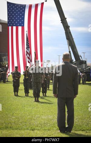 U.S. Marine Corps Maj. Gen. Niel E. Nelson, deputy commanding general of Marine Corps Combat Development Command, renders a salute to retired Lt. Gen. Frank A. Panter, during his retirement ceremony at Camp Lejeune, N.C., June 26, 2018. The ceremony was held in honor of Maj. Gen. Nelson's 35 years of honorable meritorious service. - Stock Photo