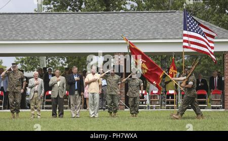 A U.S. Marine Corps Color Guard assigned to 2nd Marine Expeditionary Force conducts a pass and review during Maj. Gen. Niel E. Nelson's retirement ceremony at Camp Lejeune, N.C., June 26, 2018. The ceremony was held in honor of Maj. Gen. Nelson's 35 years of honorable and meritorious service. - Stock Photo