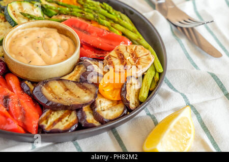 Grilled vegetables on a plate with sauce, selective focus. - Stock Photo