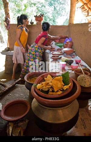 Vertical portrait of a lady cooking traditional Sri Lankan food. - Stock Photo