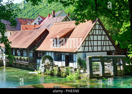 Historical hammer mill at the Blautopf, karst spring, water wheel, signal tower, Blaubeuren, Alb-Donau-Kreis, Swabian Alb - Stock Photo