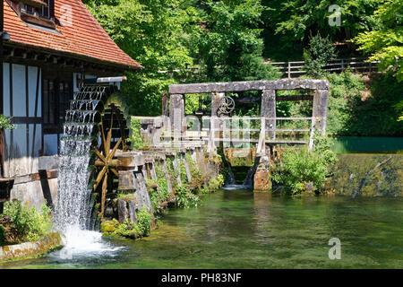 Historical hammer mill at the Blautopf, karst spring, water wheel, signal tower, Blaubeuren, Alb-Donau-Kreis, Swabian Alb - Stock Photo