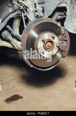 brake discs on the machine with the removed wheels on the jacks. wheel replacement close up - Stock Photo