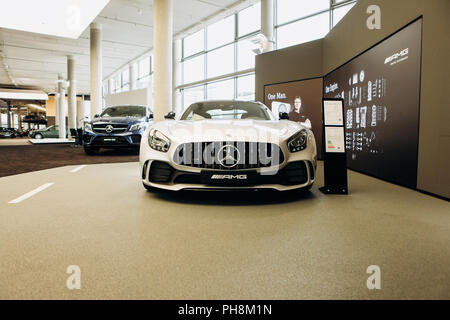 Berlin, August 29, 2018. The new white Mercedes-Benz AMG GT is sold in the official Mercedes-Benz dealership in Berlin. - Stock Photo