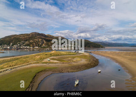 An aerial drone view of Barmouth (Y Bermo / Abermaw in welsh) - a small welsh town and seaside resort on the  mouth of the Mawddach  estuary, Gwynedd, Snowdonia National Park, North Wales UK (made by a CCA licenced and insured drone operator) - Stock Photo