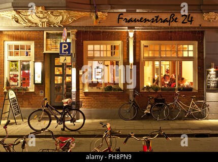 bicycles in front of inn Kulturkneipe, Muenster - Stock Photo