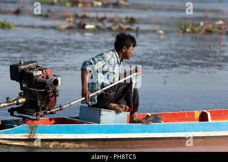 Thailand - Patthalung - Tale Noi - Fisherman in long-tailed boat - Stock Photo