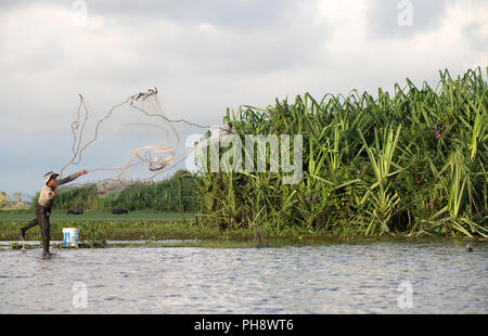 Thailand, Patthalung, Tale Noi, Fisherman with cast net - Stock Photo