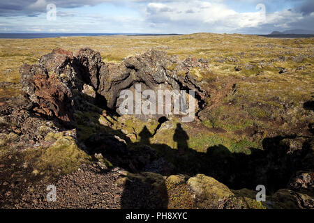 Neshraun lava field with crater, Snaefellsnes, Iceland - Stock Photo