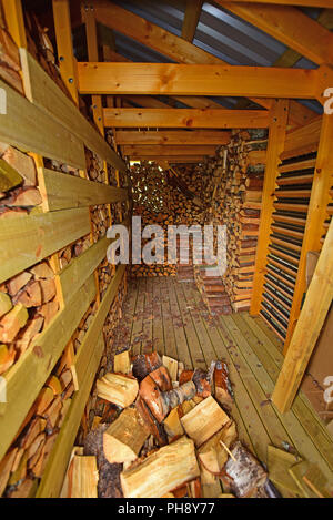 Winter fuel supply ready for the onset of the first frosts and snows on a Strathspey croft in the Cairngorms National Park - Stock Photo