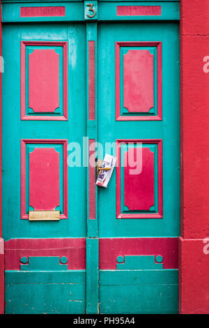 Colourful door with newspaper in Weilburg, Germany - Stock Photo