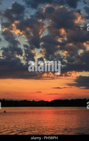 Summer clouds at sunset over Lake Pfaeffikersee - Stock Photo