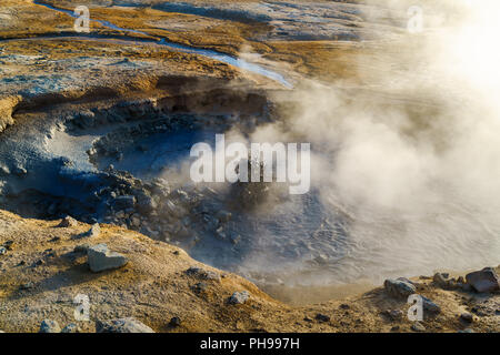 Boiling mud in the mudpot at Hverir geothermal area - Stock Photo