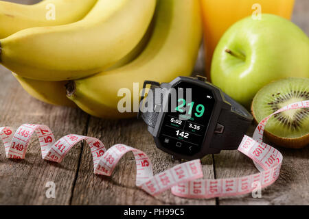 Sports watch in the foreground - Stock Photo