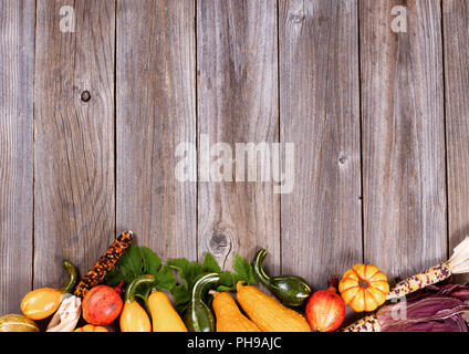 Mixed seasonal autumn vegetables on rustic wooden boards - Stock Photo