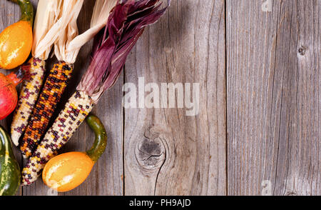 Seasonal mixed fall vegetables on rustic wooden boards - Stock Photo