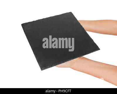 woman hand holding empty square slate platter. perspective view Template for your design. isolated on white background. - Stock Photo