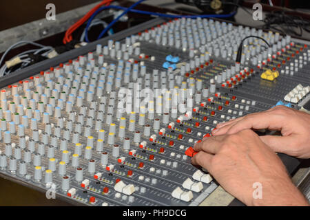Mixer is controlled and controlled by a producer - close-up - Stock Photo