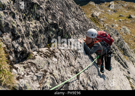 A young boy climbing in the Wiwannihorn in Switzerland - Stock Photo