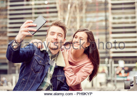 Teenage couple taking selfie together - Stock Photo