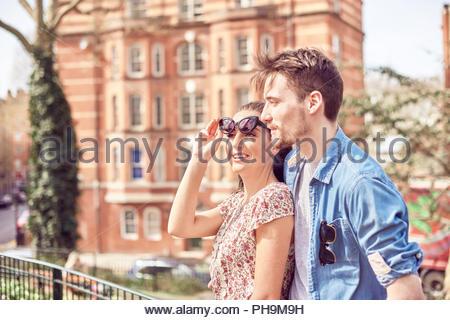 Teenage couple at park - Stock Photo