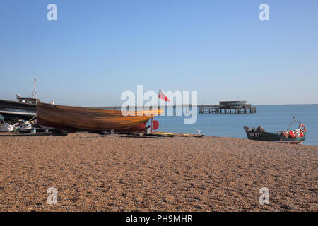 fishing boats beach with the pier and seafront in deal on the kent coast - Stock Photo