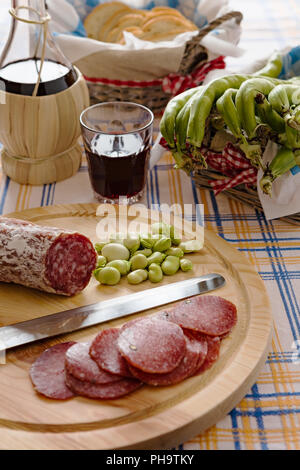 Meat chopping board of traditional Italian salami - Stock Photo