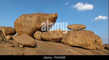 Granite boulder in Hampi popular for rock climbing - Stock Photo