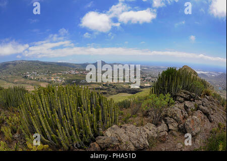 Views from the summit of Roque del Conde, towards the south coast of the island, an arid landscape with scarce endemic flora, Tenerife, Canary Islands - Stock Photo