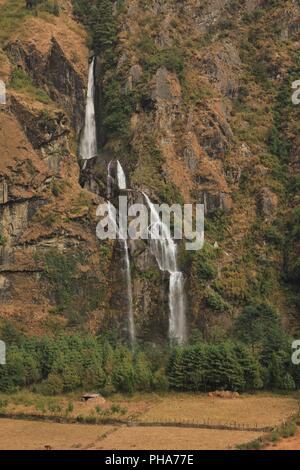 Tall waterfall in Tal, Annapurna Conservation Area - Stock Photo