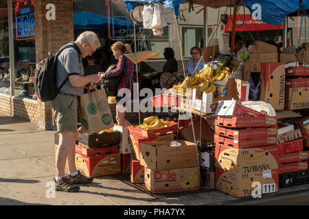 A fruit and vegetable vendor in the Chelsea neighborhood of New York on Saturday, August 25, 2018.  (© Richard B. Levine) - Stock Photo