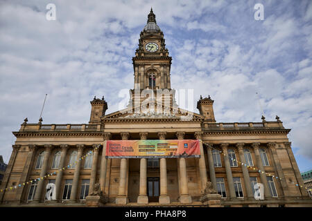 lancashire sandstone  landmark Grade II* listed building Bolton Town Hall facing Victoria Square designs by William Hill with baroque-style clocktower - Stock Photo