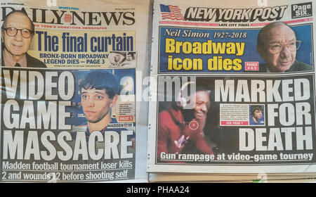 Headlines of the New York tabloid newspapers on Monday, August 27, 2018 feature similar split headlines reporting on the previous days' death of playwright Neil Simon and the mass shooting in Jacksonville, FL at a videogame tournament. (© Richard B. Levine) - Stock Photo