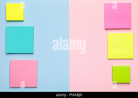 Colorful Sticky Notes on Pastel Background - Stock Photo